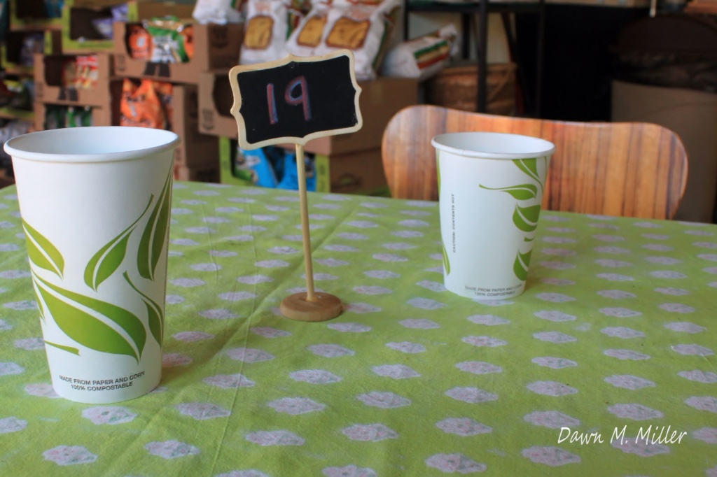 Two cups on a table numbered nineteen